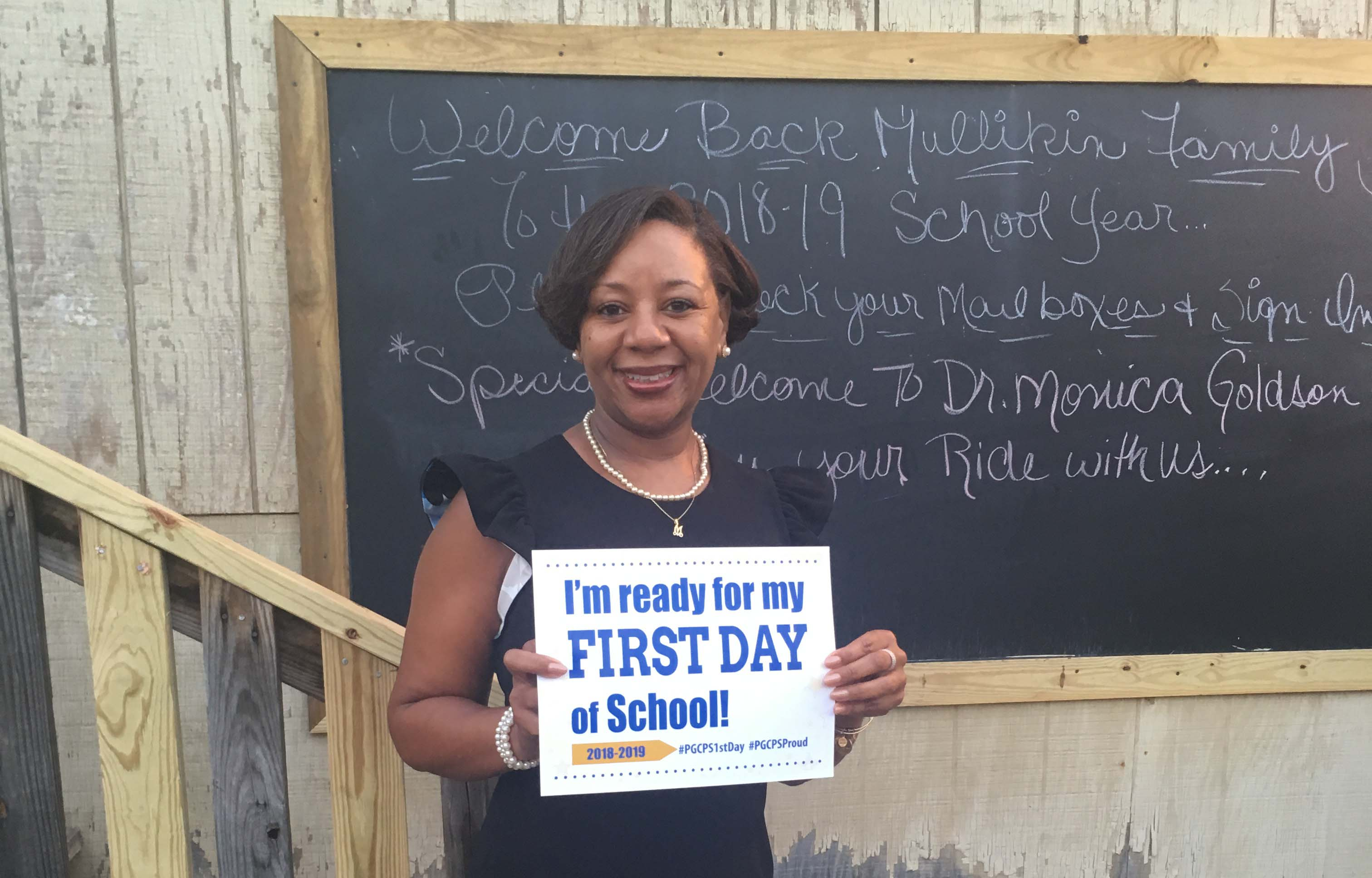 Dr. Goldson with first day sign